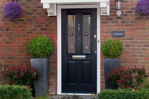 Black composite entrance door with a white frame