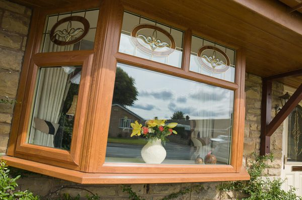 Golden oak effect uPVC bay window