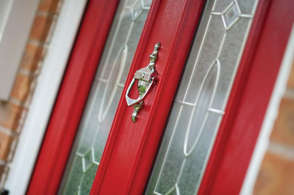 Red composite entrance door close up