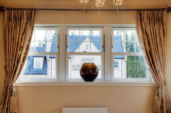Interior view of three white uPVC vertical sliding sash windows