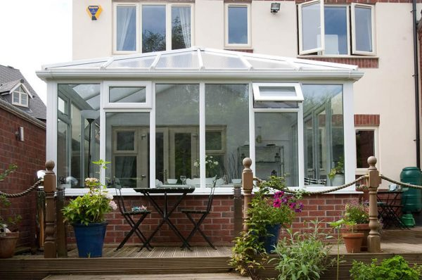White uPVC Edwardian conservatory with a glass roof