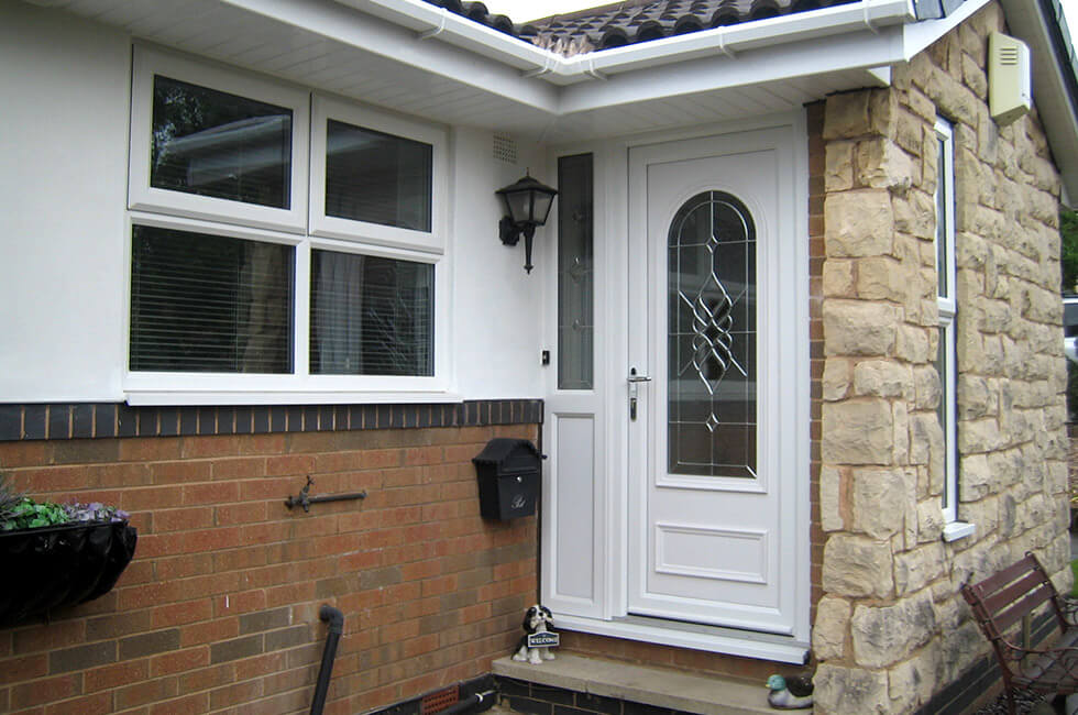 White uPVC entrance door with silver hardware