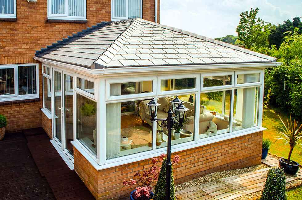 uPVC conservatory with a grey tiled roof