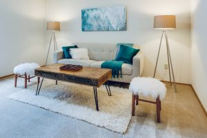 living room with coffee table and floor lamps